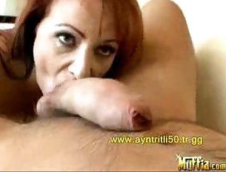 Busty milf ties up very large redhead and gets fucked