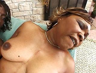 Black mature servicing a horny cock