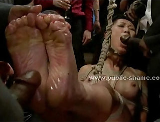 Asian slave getting fucked hard in a dildo