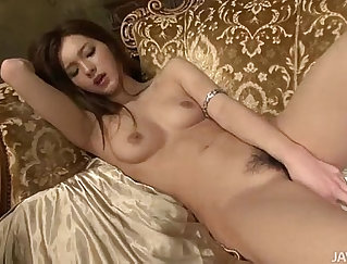 Milf has her pussy stretched out with big toys