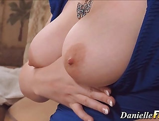 blonde that has big natural tits is getting her pussy lips stretched