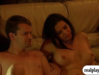 woman is having a group of men with her in the bedroom in front of the camera