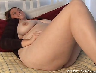 Chubby woman with a pierced nipple is fucked by a man on the bed