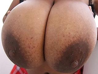 Busty Karolina shows off her big boobies