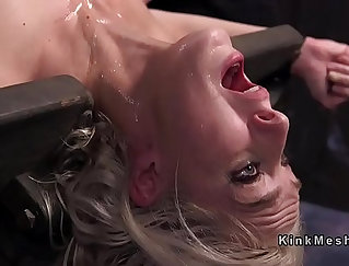 Blonde slave in bondage with big suction dick