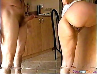 blonde milf with a nice ass is getting fucked in the kitchen