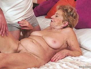 Bigtitted granny gets big cock eating & rimjob